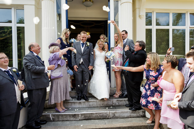 Guests throwing confetti on the newlyweds
