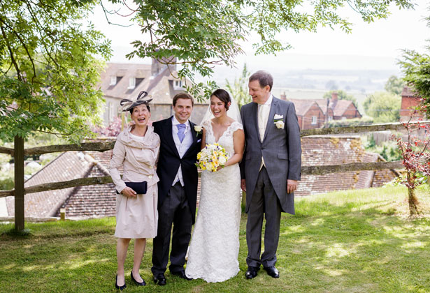 The newlyweds with the bride's parents by Douglas Fry Photography