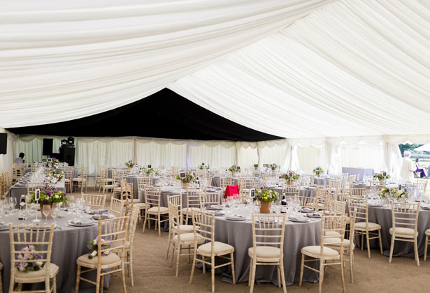 Marquee wedding with purple, yellow and green centrepieces