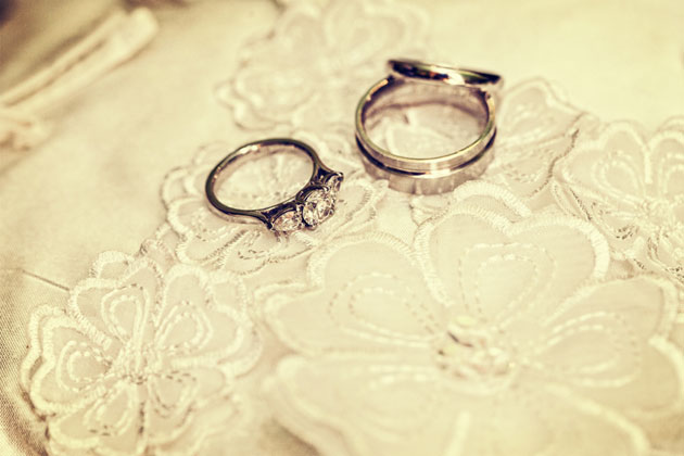 His and her silver and diamond wedding rings