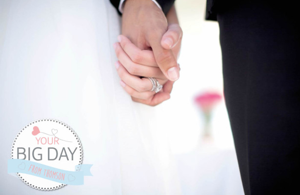 Bride and Groom holding hands wearing wedding rings