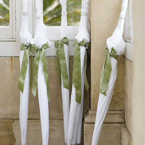 Bridal umbrellas with green ribbon at Confetti