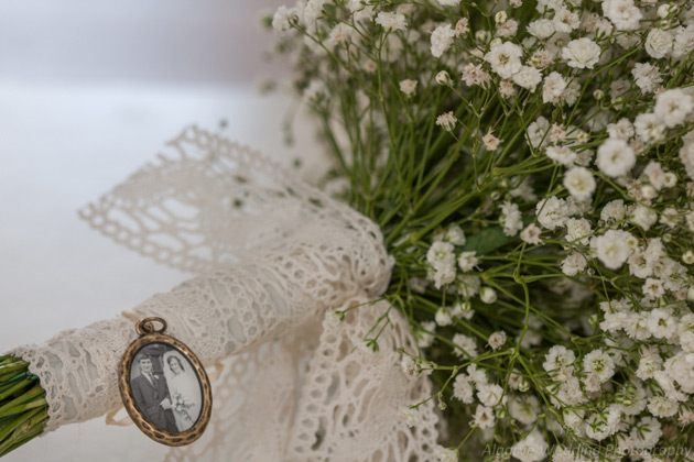 Baby breath wedding bouquet with lace handle and vintage brooch