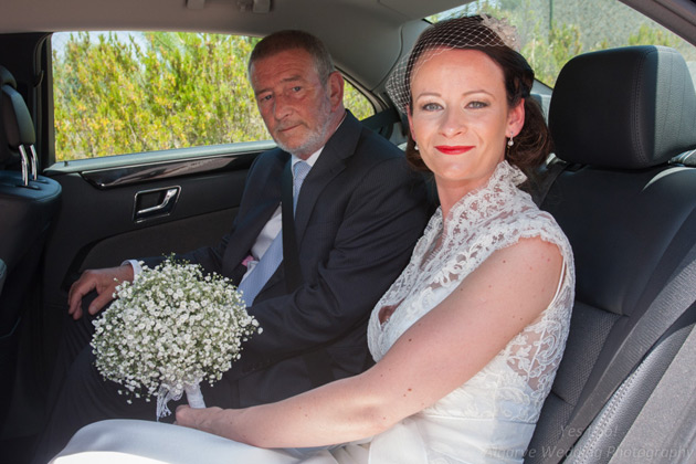 The bride and her father in the wedding car
