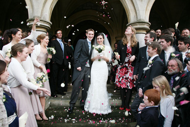 Wedding guests throwing confetti to celebrate the marriage