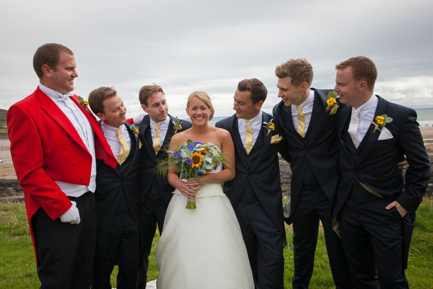 The happy couple with the groomsmen