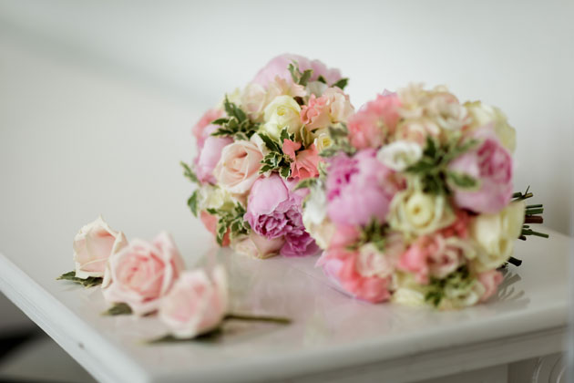 Pink and ivory wedding bouquets and pink rose button holes