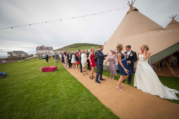 The receiving line outside the wedding tipi