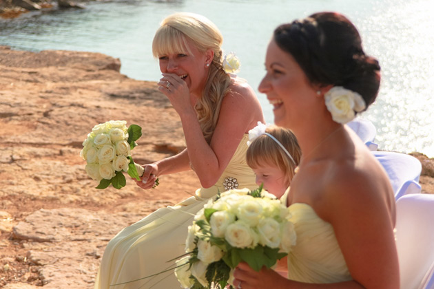 The bridesmaids enjoying the wedding ceremony
