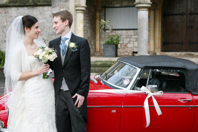 The happy couple with their red vintage MG