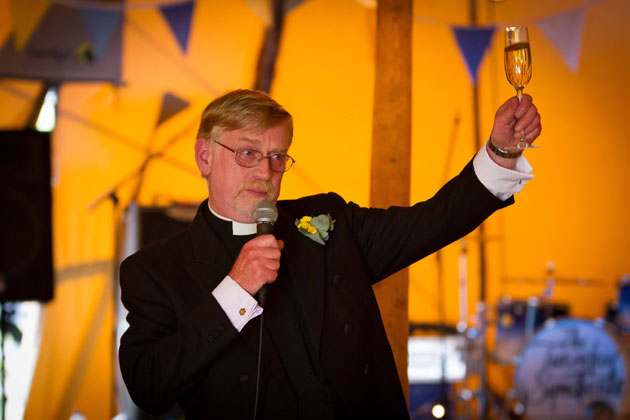 The father of the bride toasting the happy couple