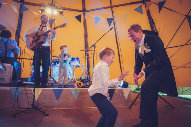 The groom and page boy enjoying the live music