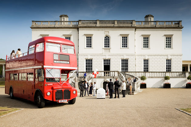 Open top red bus for the wedding guests