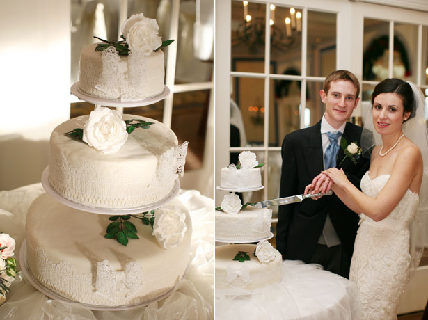 Bride and groom cutting their white lace wedding cake