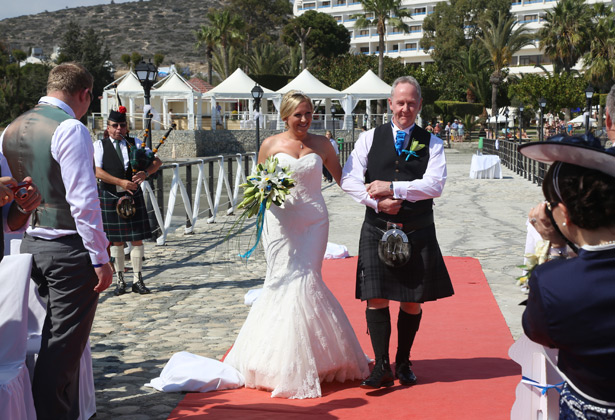 The bride's father wearing a kilt for her big day