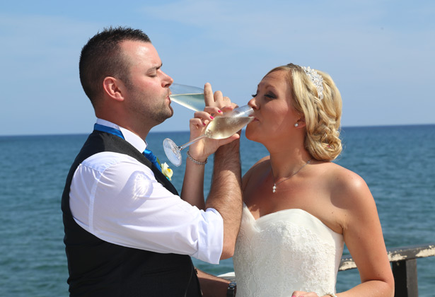 The newlyweds toasting their marriage