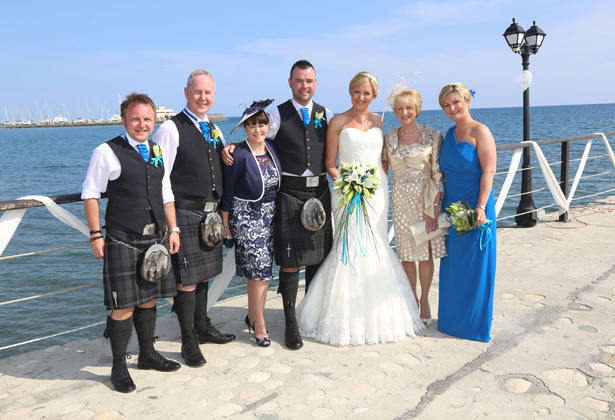 The happy couple with their family on the pier