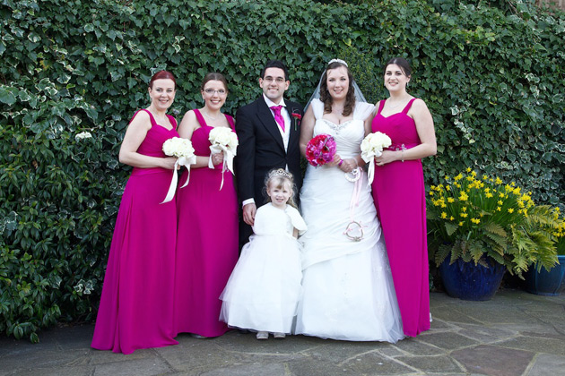 The newlyweds with their bridesmaids and the flower girl