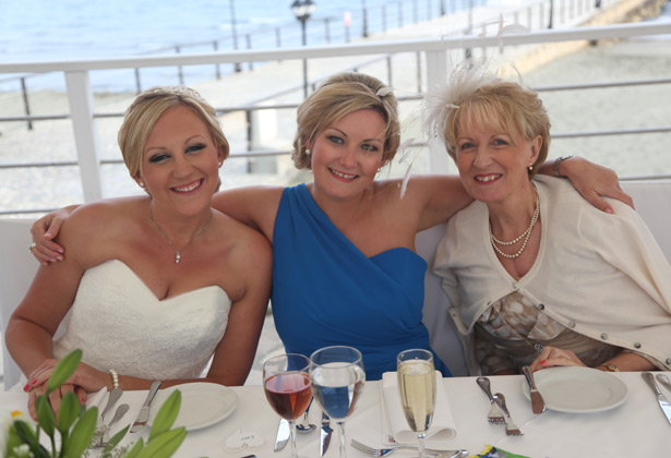 The bride with her bridesmaid and mum