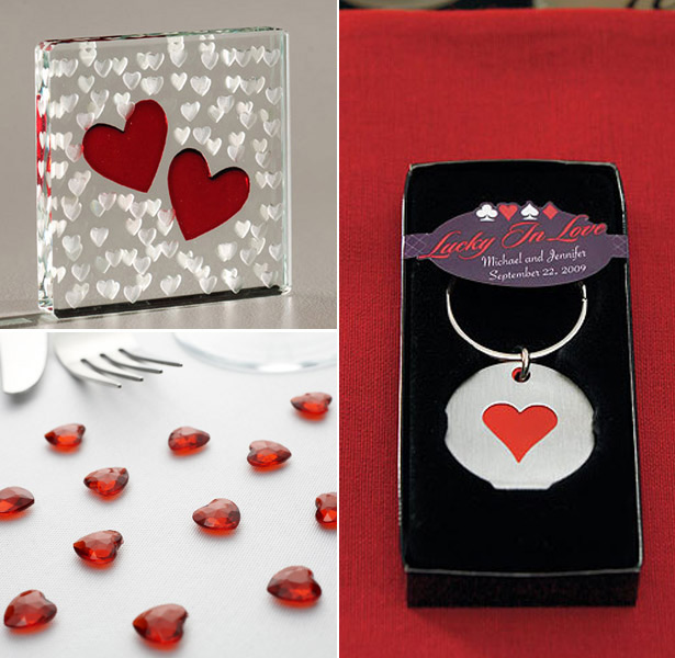 Red heart shaped wedding favours and confetti