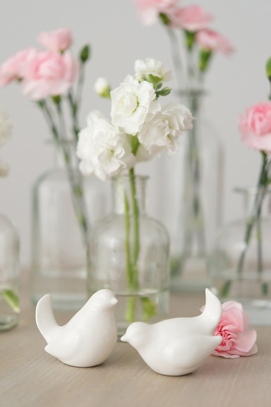 Pink and White Carnations in Glass Bottles Wedding Decor Flowers Centrepiece   Confetti.co.uk