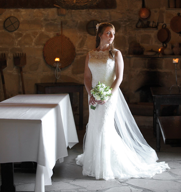 Bride in her Justin Alexander lace wedding dress