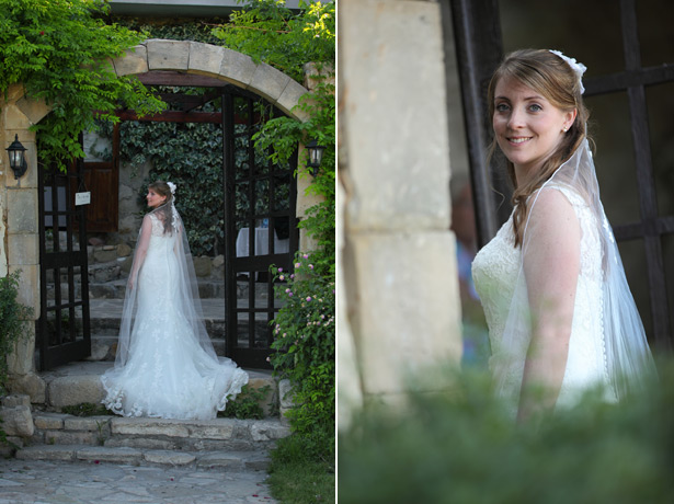 Bride in her Justin Alexander lace wedding dress with a long veil