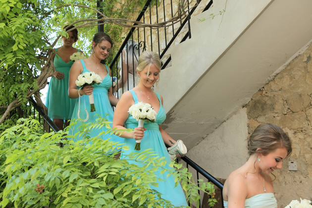 Bridesmaids walking down the stairs to the ceremony