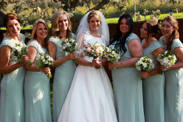 Brides with her bridesmaids in pale sage green dresses