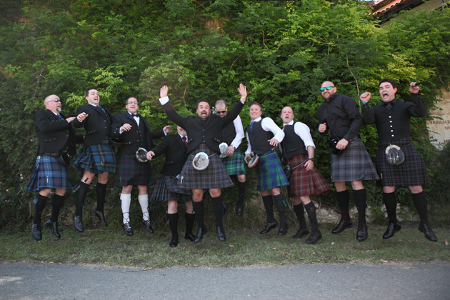 The groom and male wedding guests in kilts