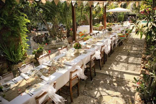 Long wedding tables with rustic themed wedding decor