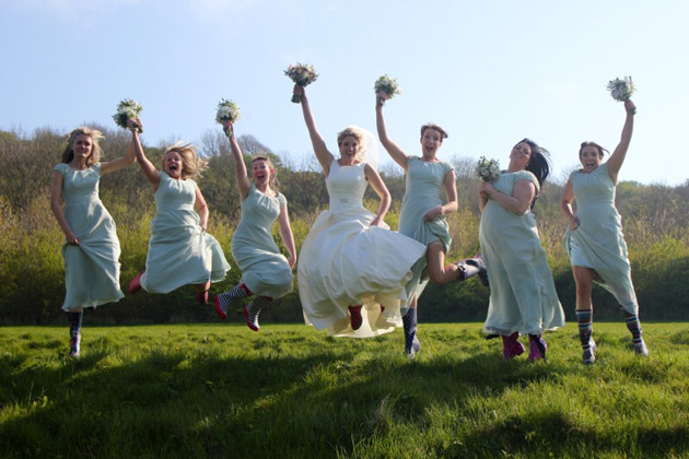 Bride and her bridesmaids jumping