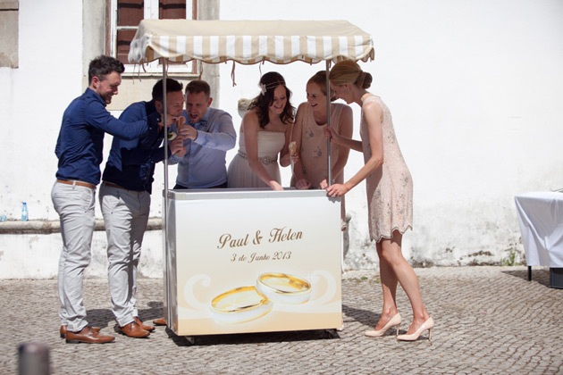 The bride and groom with their bridesmaids and groomsmen at a personalised ice cream cart