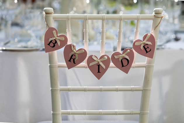Heart shaped bride banner across the chair