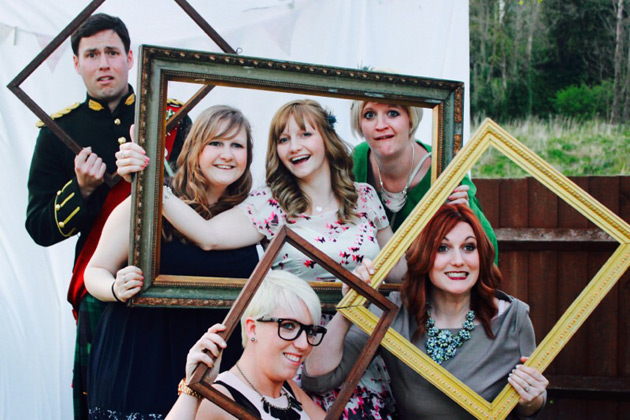 Groom and the wedding guests holding photo frames