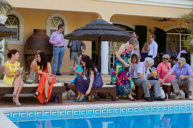 Guests relaxing by the pool in a private villa in Vilamoura