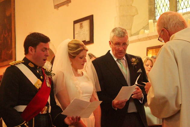 The bride and groom singing hymns during the ceremony