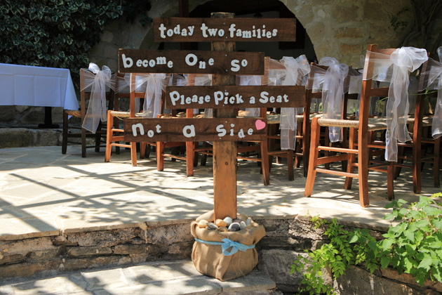 Today two families become one so please pick a seat not a side, wooden sign