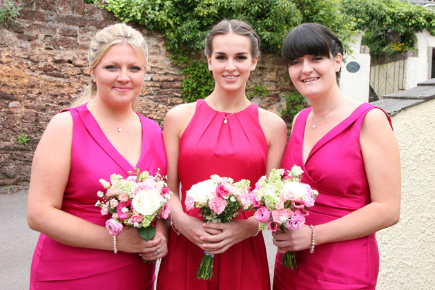 Bridesmaids in hot pink sleeveless satin dress from Alexon and from Coast| Confetti.co.uk