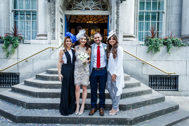 The newlyweds with their wedding guests| Confetti.co.uk