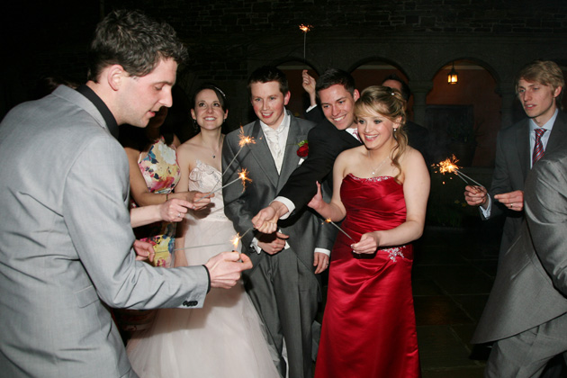 Guests lighting sparklers | Confetti.co.uk