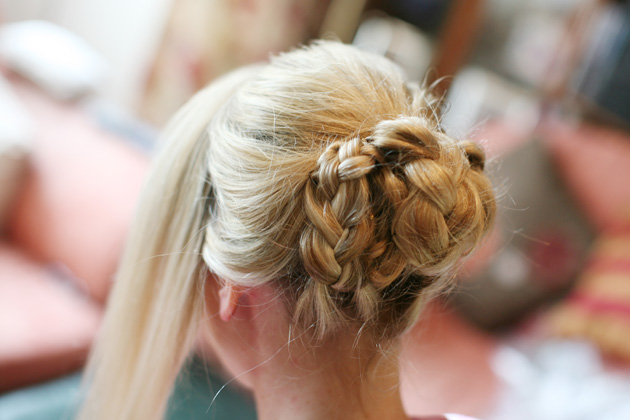 Wedding hairstyle idea: braided bridal bun| Confetti.co.uk