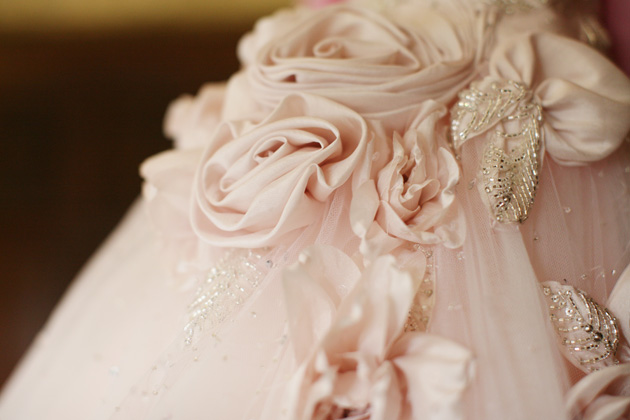 Blush pink wedding dress with rose detail | Confetti.co.uk