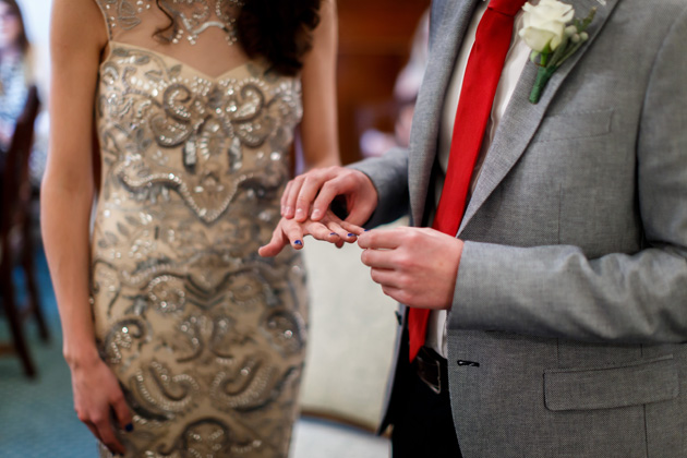 The groom placing the ring on the brides finger | Confetti.co.uk