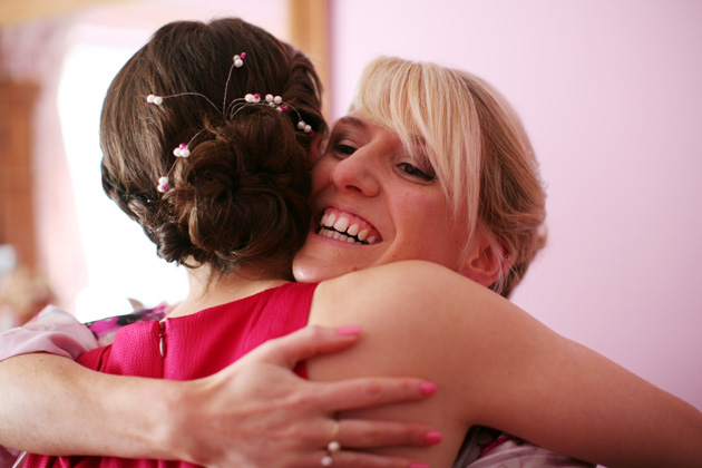Wedding emotions: a bride and bridesmaid share a hug before the ceremony | Confetti.co.uk