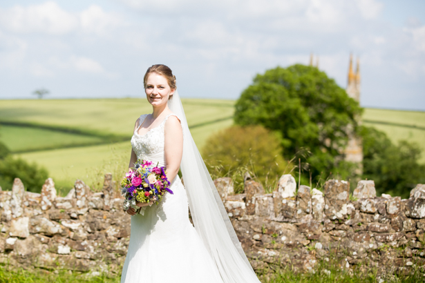 Bride in her Mon Cheri lace wedding dress | Confetti.co.uk