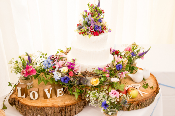 Rustic themed wedding cake with wildflower decor | Confetti.co.uk