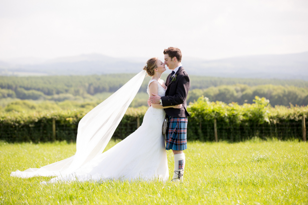 The bride and groom by Evolve Photography | Confetti.co.uk
