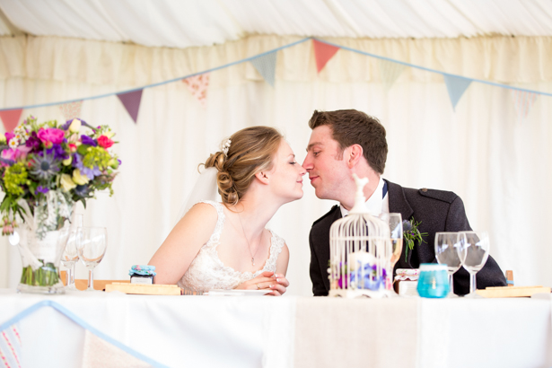 Bride and groom at the top table | Rustic wedding decor | Confetti.co.uk