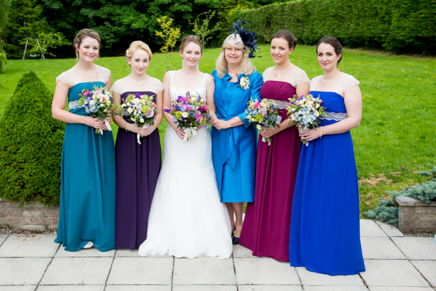 Bride with her bridesmaids in their Alfred Angelo dresses | Confetti.co.uk
